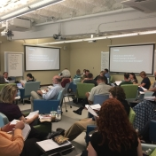 a group of faculty discuss critical reading in the Noel Studio